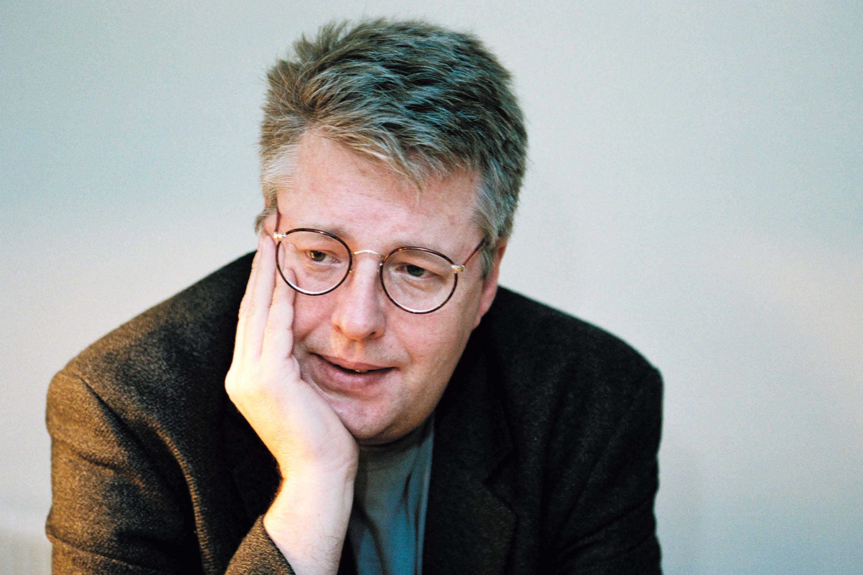 "Stieg Larsson, author of ""The Girl With the Dragon Tattoo,"" sits for a photo in Stockholm, Sweden, on Nov. 2, 2004. His book is published by the Knopf unit of Random House and retails for $24.95. Photographer: Britt-Marie Trensmar/SCANPIX/Random House via Bloomberg News  EDITOR'S NOTE: NO SALES. EDITORIAL USE ONLY."