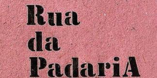 """Recorte da capa do livro """"Rua da Padaria"""". Na imagem, o título do livro em preto num fundo rosa texturizado."""